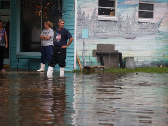 John Hargan looks off over the flooded streets Monday