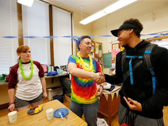 """Students greet and congratulate Jack Schuler (center) as they come in and out of his """"It's a Boy"""" party Friday, May 20, 2016, at Lincoln High School in Des Moines."""