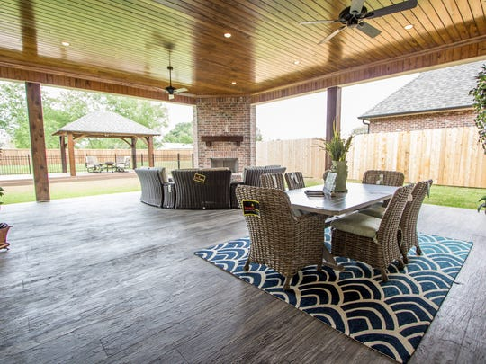 The outdoor space include a fireplace and gazebo.
