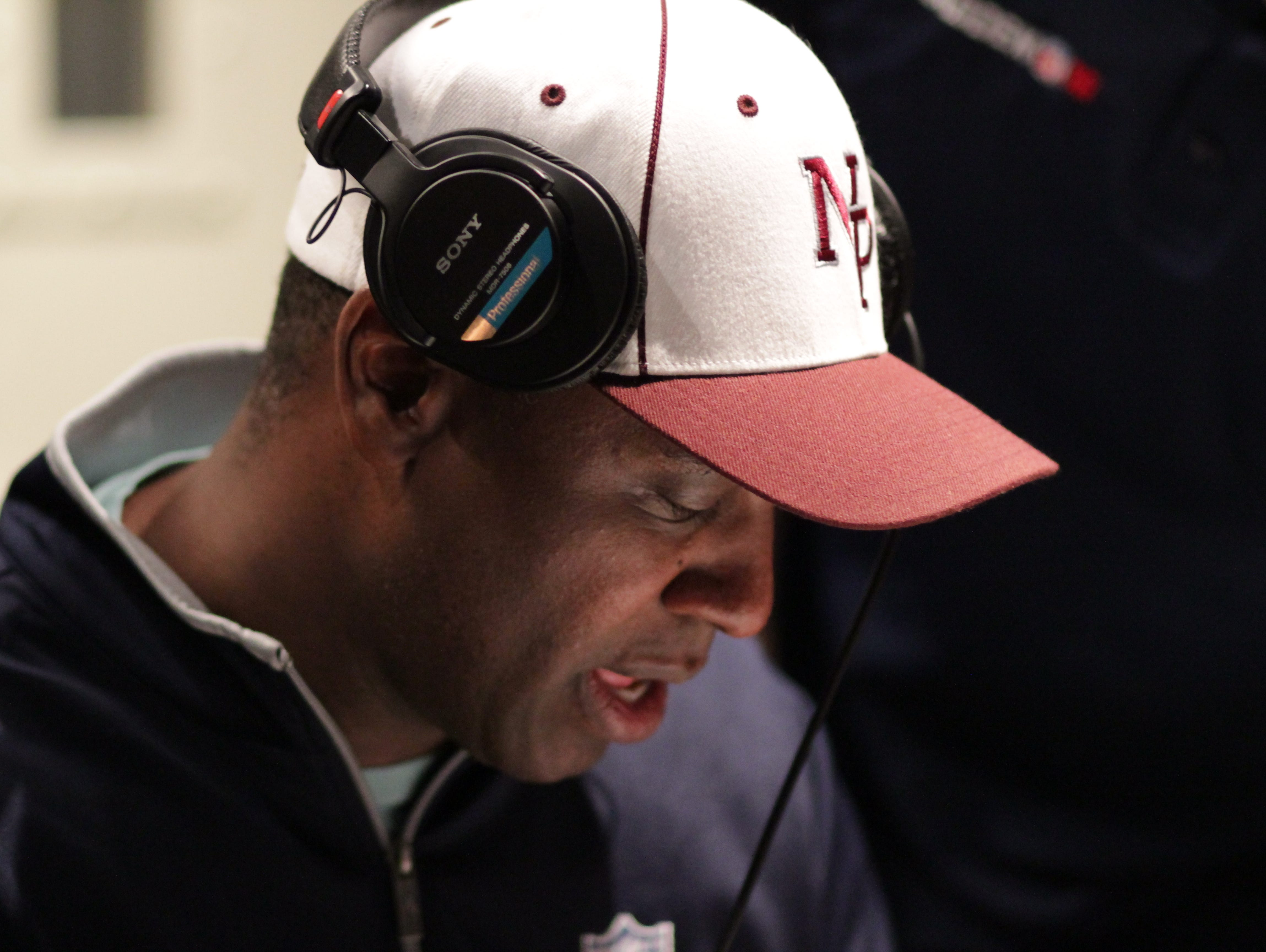New Paltz native Charles Davis, wearing a New Paltz High School hat, reads his lines for the Madden NFL 17 video game at the Madden NFL studio at EA Sports.