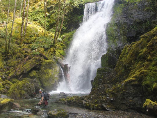 Jeff Green crosses Henline Creek below Jerry Falls in the Family Falls series of waterfalls.