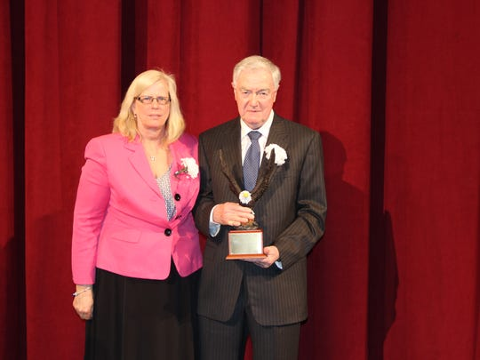 Richard Shine Sr. of Milltown received the Albert Hudanish Leadership Award at the apprentice graduation of the Middlesex County Vocational and Technical Schools. At left is Dawn J. Lystad, MCVTS director of adult education and Middlesex County apprenticeship coordinator.
