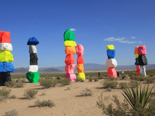 The Seven Magic Mountains consists of seven towers with a total of 33 boulders, each weighing approximately 44,000 pounds.