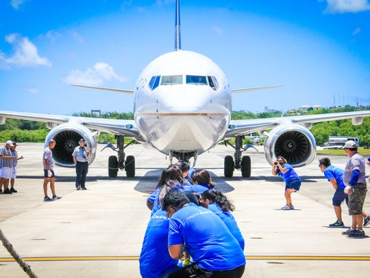 "A team competes at the United ""Towing the Line to Save Lives"" Plane Pull."