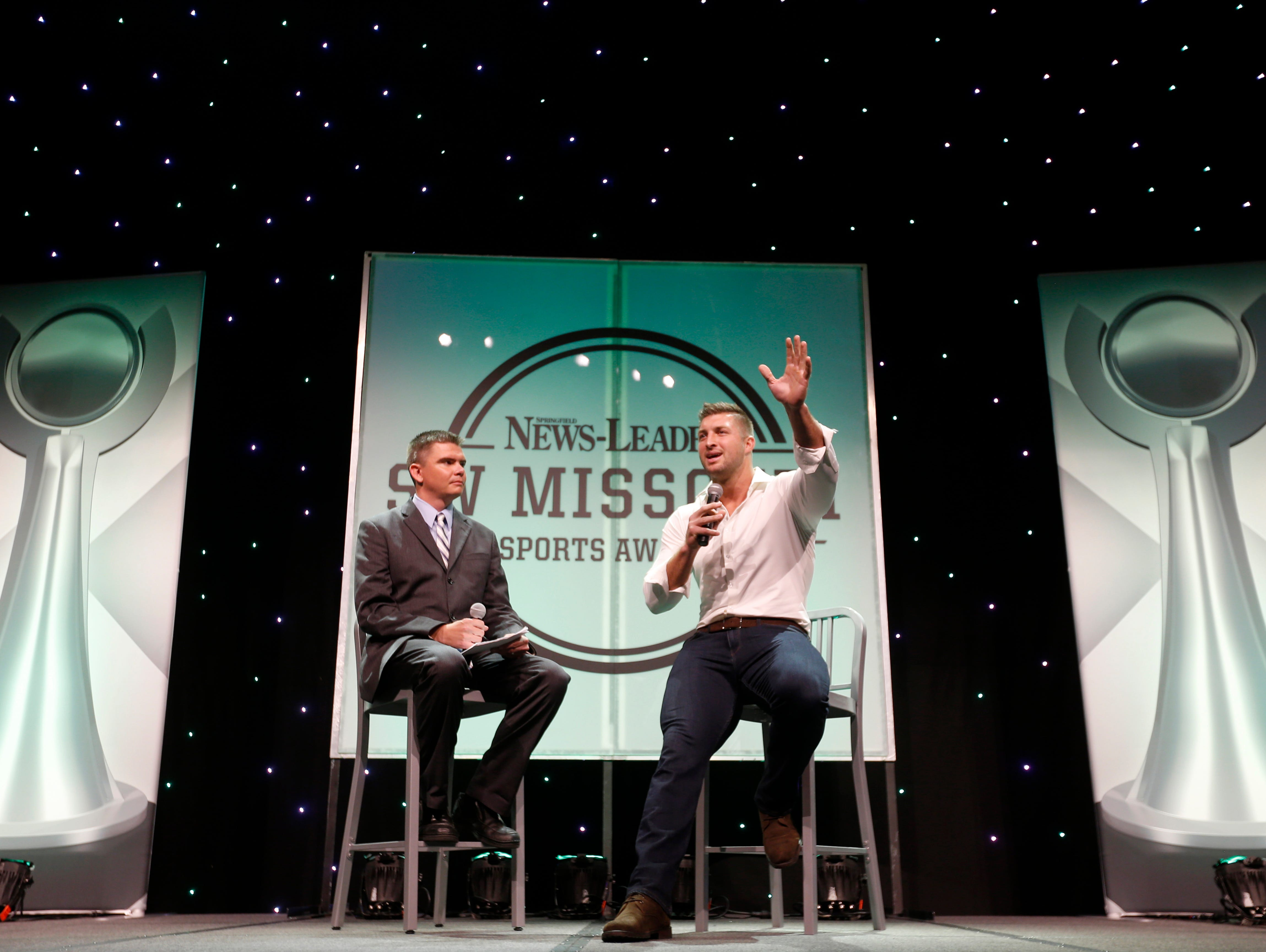News-Leader prep sports reporter Rance Burger interviews Tim Tebow during the 2016 Southwest Missouri Sports Awards at the Springfield Expo Center on Thursday, June 9, 2016.