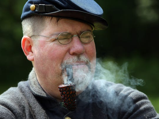 George Cavallone of Dumont smokes a pipe during Historic Speedwell's annual ÔCivil War Weekend,Õ a two-day event sponsored by the Second New Jersey Brigade and the Morris County Park Commission. June 11, 2016, Morristown, NJ