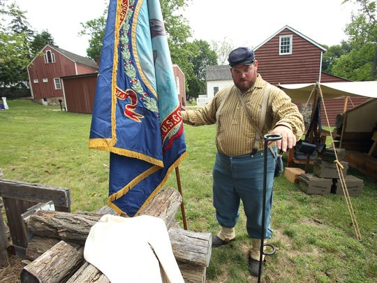 Brian Zilinski of Andover plants the flag during Historic Speedwell's annual ÔCivil War Weekend,Õ a two-day event sponsored by the Second New Jersey Brigade and the Morris County Park Commission. June 11, 2016, Morristown, NJ