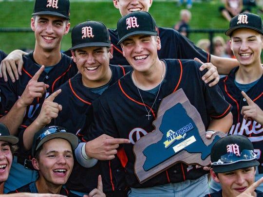 Members of the Marlboro High School baseball team celebrates its state titlel in Endwell on June 11.