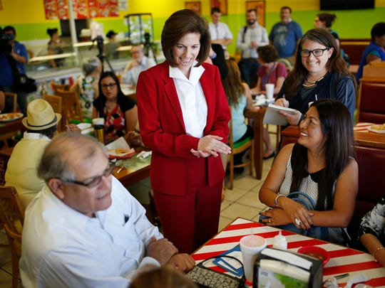 U.S. Senate candidate Catherine Cortez Masto, center,