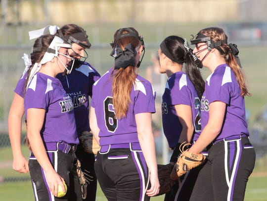Clarksville High's infield huddles at the pitcher's