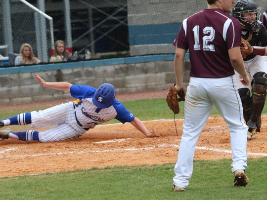 Clarksville Academy's Michael Conn slides into home