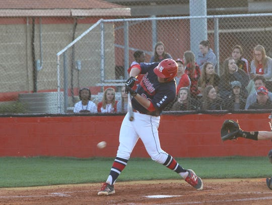 Rossview's Bradley Wilson takes a swing at a pitch
