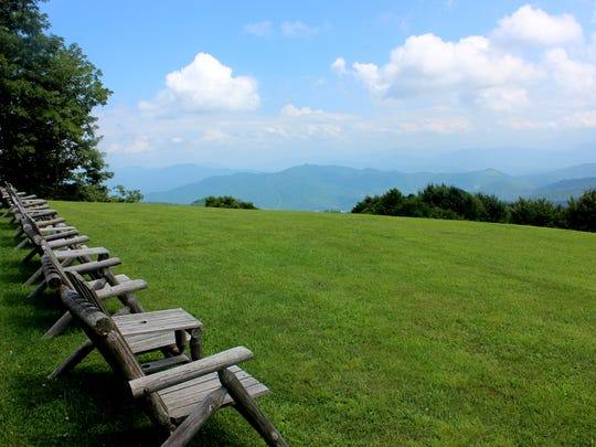 Rustic chairs on Gooseberry Knob at The Swag await inhabitants to enjoy their majestic mountain views.