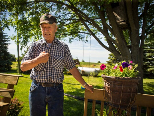 Farmer Bill Carter at his home in rural Lacona, Iowa, Thursday June 16, 2016. His wife Shirley was murdered at their home a year ago June 19 - he shows how he found her on the kitchen floor, shot through the back and chest. There have been no arrests yet in the case.