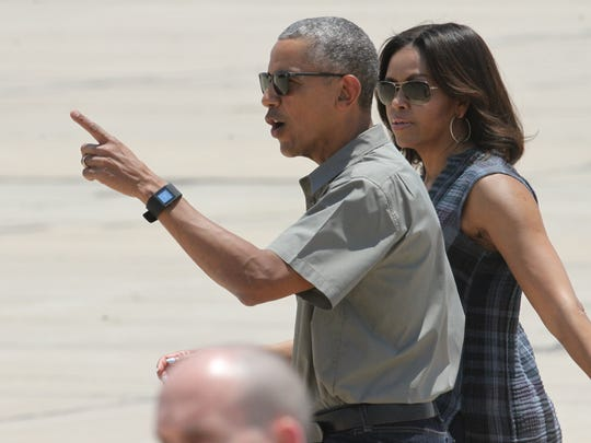 President Barack Obama and First Lady Michelle Obama arrive at Roswell International Air Center.