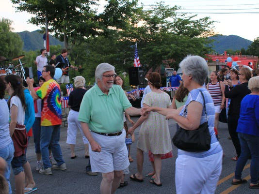 Street dance-Many-in-the-crowd-enjoy-dancing-to-the-96.5-House-Band-during-the-street-dance-in-Black-Mountain-on-July-4-2014-photo-by-Fred-McCormick.jpg