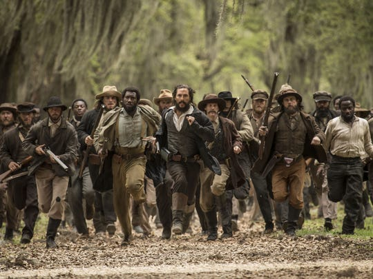 "Matthew McConaughey (center) and Mahershala Ali (center left) star in ""Free State of Jones."""