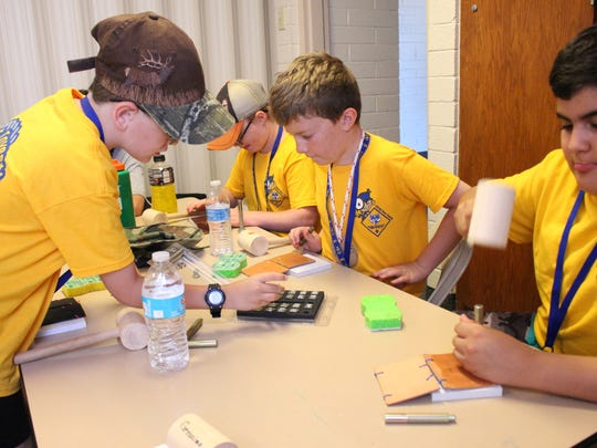At the Cub Scout Investigators Camp, scouts learned the basics of leather working skills by designing their own leather wallets.