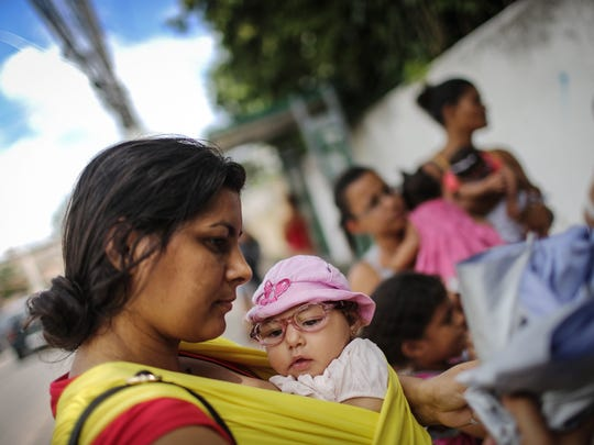 Mother Jusikelly da Silva holds her 7-month-old daughter