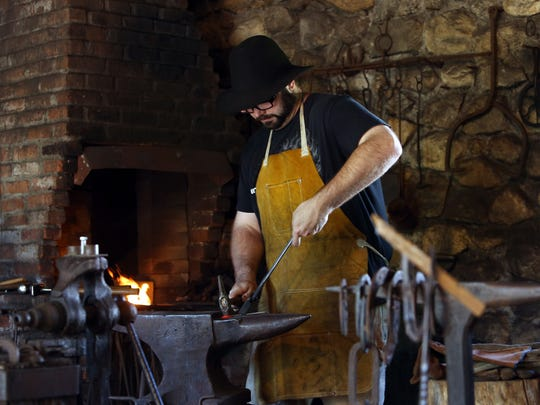 Blacksmith Richard Brusk of Brookside works during the Waterloo Village hosted annual Canal Day Festival, a day of family fun and entertainment. June 25, 2016, Stanhope, NJ