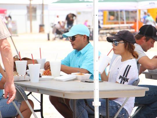 People eat food at Smokin on the Pecos.