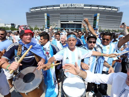 Argentinian fans chant before the game, tailgating in the parking lot of MetLife Stadium before the historic Argentina vs. Chile final of the 100th anniversary Centennial Copa America at MetLife Stadium, June 26, 2016, East Rutherford, NJ