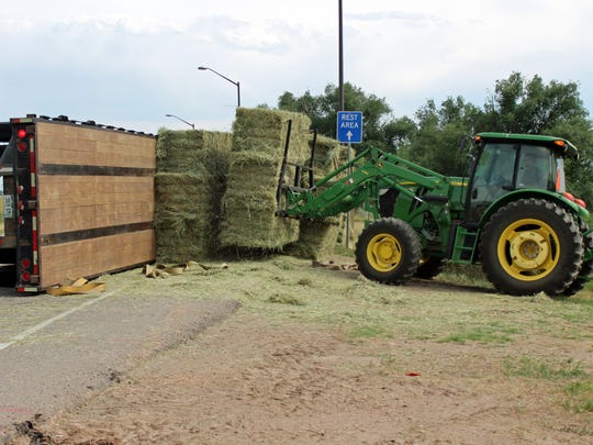 A semi carrying hay to a Fort Collins farm rolled Wednesday