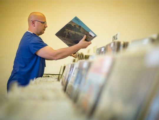 Customer Levi Chodur of Ankeny checks the selection