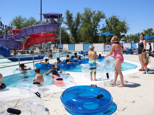 Residents clamber into the water park's lazy river.