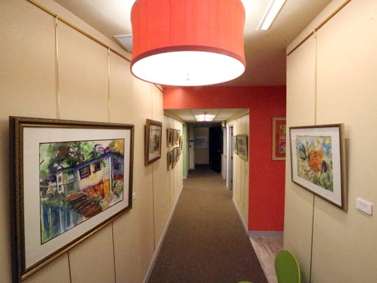 A hallway inside the Star City Studoo Productions features art by Pat Olchefski-Winston.