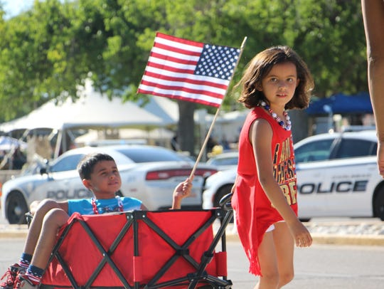 Children watch the annual Fourth of July parade at