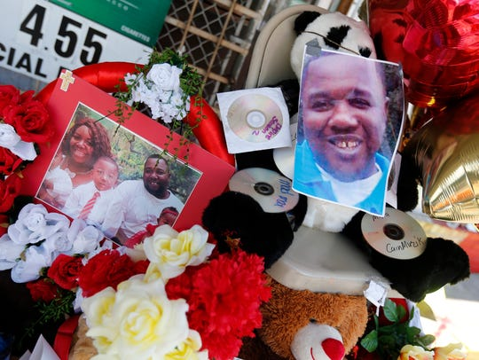 Photos of Alton Sterling are interspersed with flowers