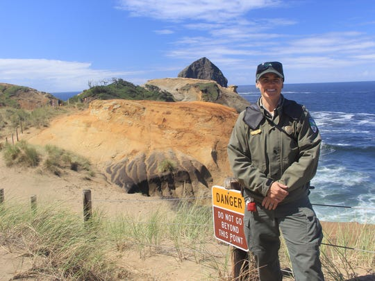 Lisa Stevenson is a park ranger who educates the public about the dangers of crossing the fence at Cape Kiwanda.