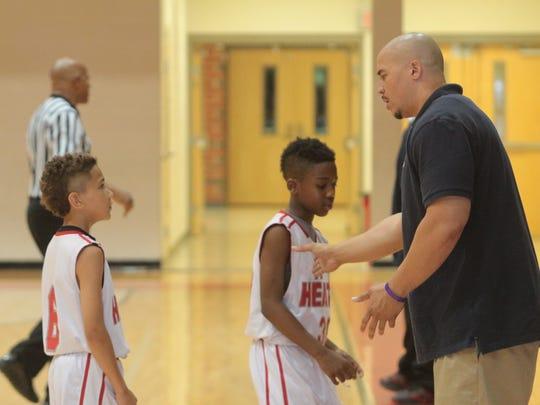 FA Heat head coach Warren Henson instructs two of his