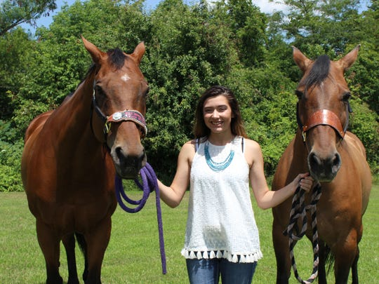 Jalynn Fausnaugh, 15, poses with her barrel horse,