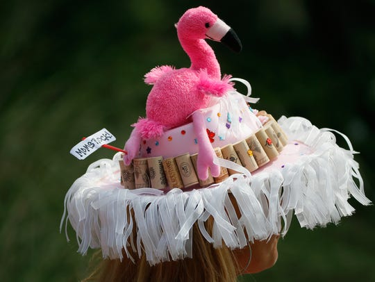 Creative flamingo-themed hats can often be spotted