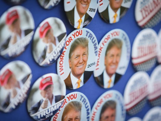 Donald Trump buttons are shown outside of a political rally in Harrington on April 22. Delaware Republicans say Democrats and insiders are lashing out against Trump because he isn't just another politician.