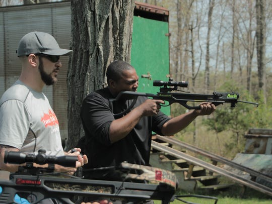 Learn how to fire a weapon at Zombie Survival Camp.