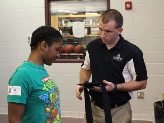Valerie Samuel (left), 10th grader at Pensacola Hig, and Alan Ray, ATC with the Andrews Institute go through cognitive evalutions as part of baseline concussion testing.