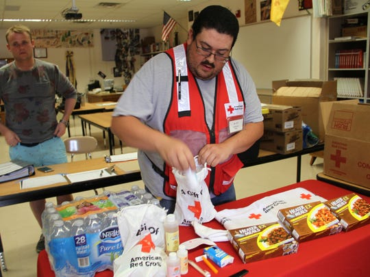 A member of the Red Cross prepares supplies for Timberon