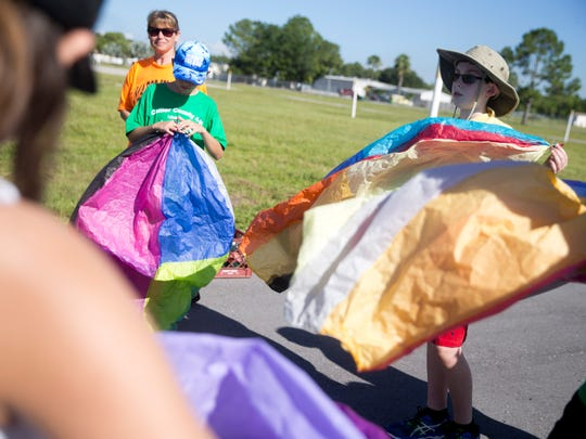 Campers prepare to release their hand made weather balloons for testing at the Collier County Fairgrounds during the Southwest Florida Weather Camp Friday, July 15, 2016 in Naples, Fla. The week-long camp gives kids a chance to learn about the weather through hands on experiments and research.