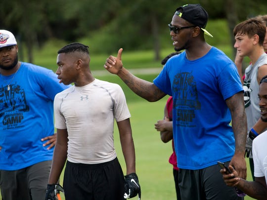 Javarris James, right, cousin of Edgerrin James and