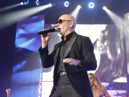 Pitbull serenades the crowd on Wednesday in El Paso.