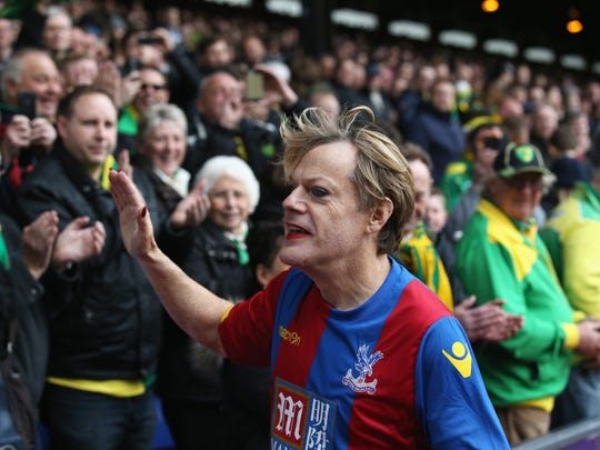 Comedian Eddie Izzard attracts the crowd at halftime during the Barclays Premier League match between Crystal Palace and Norwich City at Selhurst Park on April 9, 2016, in London.