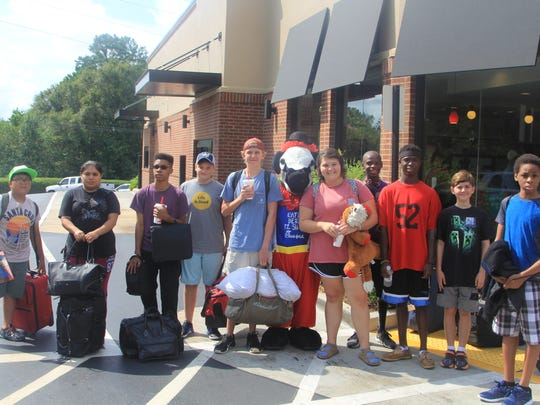 Campers - and the Chick-fil-A cow - get ready to load
