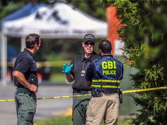 636058384207131611-Bodies-Found-Behind-S-Thad.jpg
