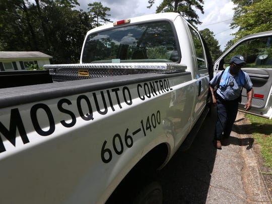 Leon County Mosquito Technician Gerald Edwards answers a house call from a resident that is having mosquito problems Tuesday.