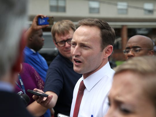 U.S. Rep. Patrick Murphy talks to the press while on a visit with Vice President Joe Biden at Olean's Cafe on Adams Street in Tallahassee on Friday.