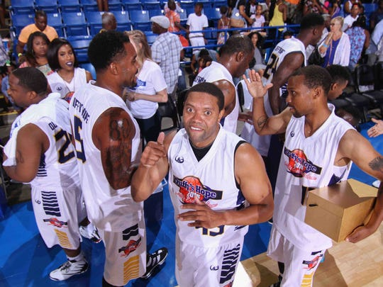 Rick Deadwyler (45) celebrates after the conclusion of the 2015 Duffy's Hope Celebrity Basketball Game. This year's is set for Saturday.