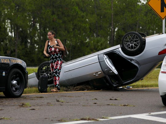A single-car rollover accident slows traffic on the southbound onramp of Interstate 75 at Immokalee Road on Monday, Aug. 8, 2016, in North Naples.